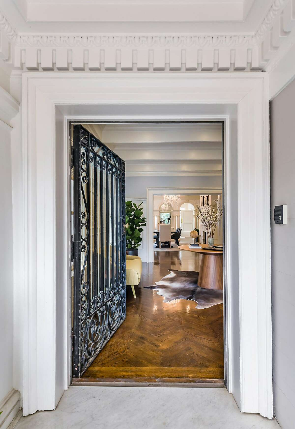 The home opens through a portico to a handsome foyer.