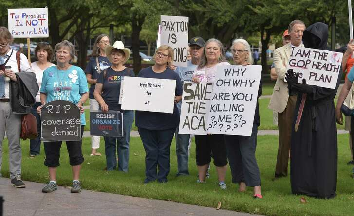Supporters of the Affordable Care Act protest during a rally at Burnett Park in Fort Worth, Texas, Wednesday, Sept. 5, 2018. (Max Faulkner/Fort Worth Star-Telegram/TNS)