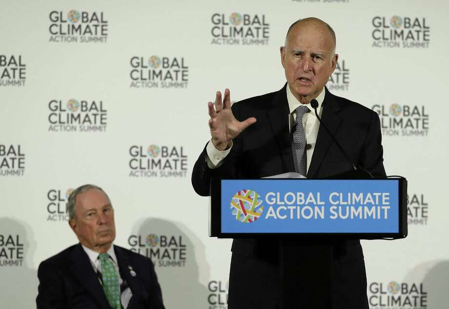 California Gov. Jerry Brown speaks as Michael Bloomberg, left, listens during a news conference at the Global Action Climate Summit Thursday, Sept. 13, 2018, in San Francisco. Gov. Brown started his global climate summit by saying that President Donald Trump will likely be remembered as a liar and fool when it comes to the environment. The Democratic Brown and former New York City Mayor Michael Bloomberg held a press conference Thursday on the first full day of the summit that is partly a rebuke of the Trump administration. Photo: Eric Risberg / Associated Press / Copyright 2018 The Associated Press. All rights reserved