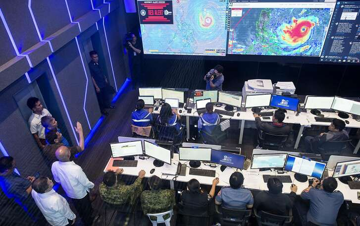 Philippine President Rodrigo Duterte (4th L, arm upraised) gestures while visiting the National Disaster Risk Reduction and Management Council (NDRRMC) Operations Center at Camp Aguinaldo in Manila on September 13, 2018, as Typhoon Mangkhut barrels toward the Philippines. - A super typhoon roared toward the Philippines on September 13, prompting thousands to evacuate ahead of its heavy rains and fierce winds that are set to strike at the weekend before moving on to China. (Photo by NOEL CELIS / AFP)NOEL CELIS/AFP/Getty Images
