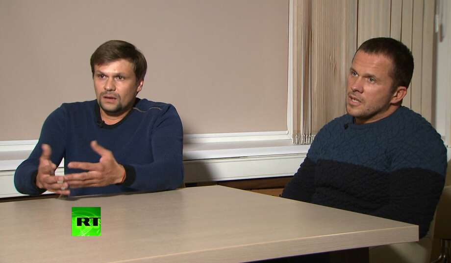 In this video grab provided by the RT channel , Ruslan Boshirov, left, and Alexander Petrov attend their first public appearance in an interview with the Kremlin-funded RT channel in Moscow, Russia, Thursday, Sept. 13, 2018. The two Russian men charged in Britain with poisoning a former Russian spy with a deadly nerve agent appeared on Russian television on Thursday, saying they visited the suspected crime scene as tourists. (RT channel video via AP) Photo: Associated Press