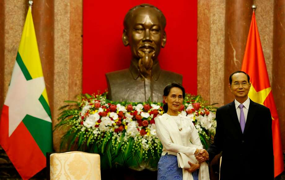 Aung San Suu Kyi (left) poses with Vietnam President Tran Dai Quang at an economic forum in Hanoi. Photo: Kham / AFP / Getty Images