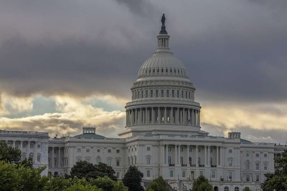 This Wednesday, Aug. 1, 2018, file photo shows the Capitol in Washington. Congress is heading toward a post-election showdown over President Donald Trump's border wall, as GOP leaders signal they're willing to engage in hardball tactics that could spark a partial government shutdown and the president revs up midterm crowds for the wall, a centerpiece of his 2016 campaign and a top White House priority. Photo: J. Scott Applewhite, Associated Press