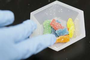 In this Wednesday, Aug. 22, 2018, photo, edible marijuana samples are set aside for evaluation at Cannalysis, a cannabis testing laboratory, in Santa Ana, Calif. Nearly 20 percent of the marijuana and marijuana products tested in California for potency and purity have failed, according to state data provided to The Associated Press. (AP Photo/Chris Carlson)