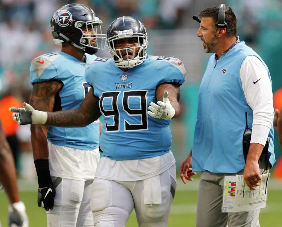 Tennessee Titans head coach Mike Vrabel talks to defensive tackle Jurrell Casey (99), following a scuffle on the field, during the second half of an NFL football game against the Miami Dolphins, Sunday, Sept. 9, 2018, in Miami Gardens, Fla. (AP Photo/Brynn Anderson) Photo: Brynn Anderson, Associated Press / Copyright 2018 The Associated Press. All rights reserved.