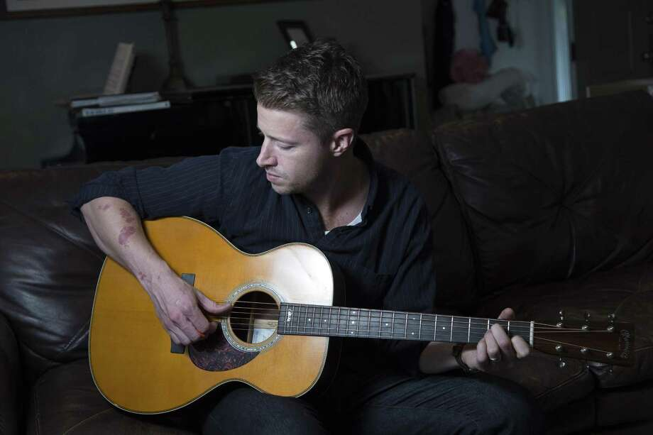 William Evans, of Trumbull, on the guitar. Evans, 37, used medication to recover from an opioid addiciton. Photo: Derek Torrellas / For Connecticut Health I-Team