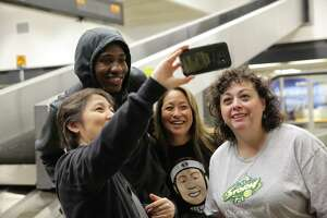 Fans take a selfie with Seattle Storm forward Natasha Howard at Sea-Tac Airport as the team arrives home after sweeping the WNBA finals against the Washington Mystics, Thursday morning, Sept. 13, 2018.