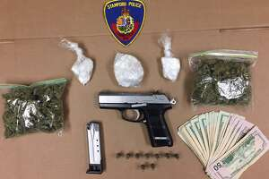 A Ruger semiautomatic pistol, nearly six ounces of cocaine, four ounces of marijuana, $758 in cash and a loaded magazine filled with bullets seized in a drug bust on Wardwell Street in Stamford on Sept, 12, 2018.