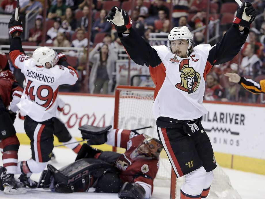 FILE - In this March 9, 2017, file photo, Ottawa Senators defenseman Erik Karlsson (65) celebrates after scoring a goal against the Arizona Coyotes during the third period during an NHL hockey game in Glendale, Ariz. The San Jose Sharks have acquired two-time Norris Trophy-winning defenseman Erik Karlsson from the Senators, the teams announced Thursday, Sept. 13, 2018. ( AP Photo/Rick Scuteri) Photo: Rick Scuteri / Associated Press
