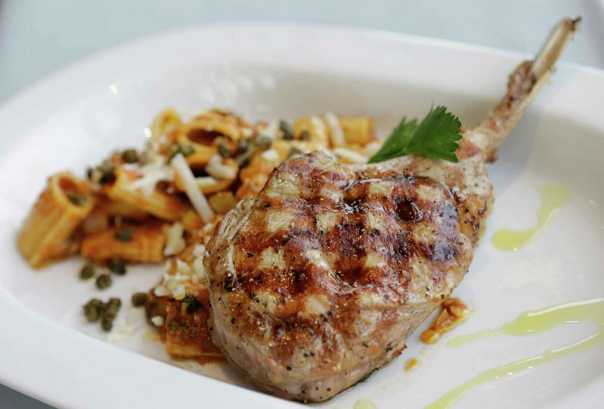 Veal chop with a ragout of mushrooms and tomato and buttered rigatoni with fried capers at Diana American Grill at the Hobby Center for the Performing Arts.