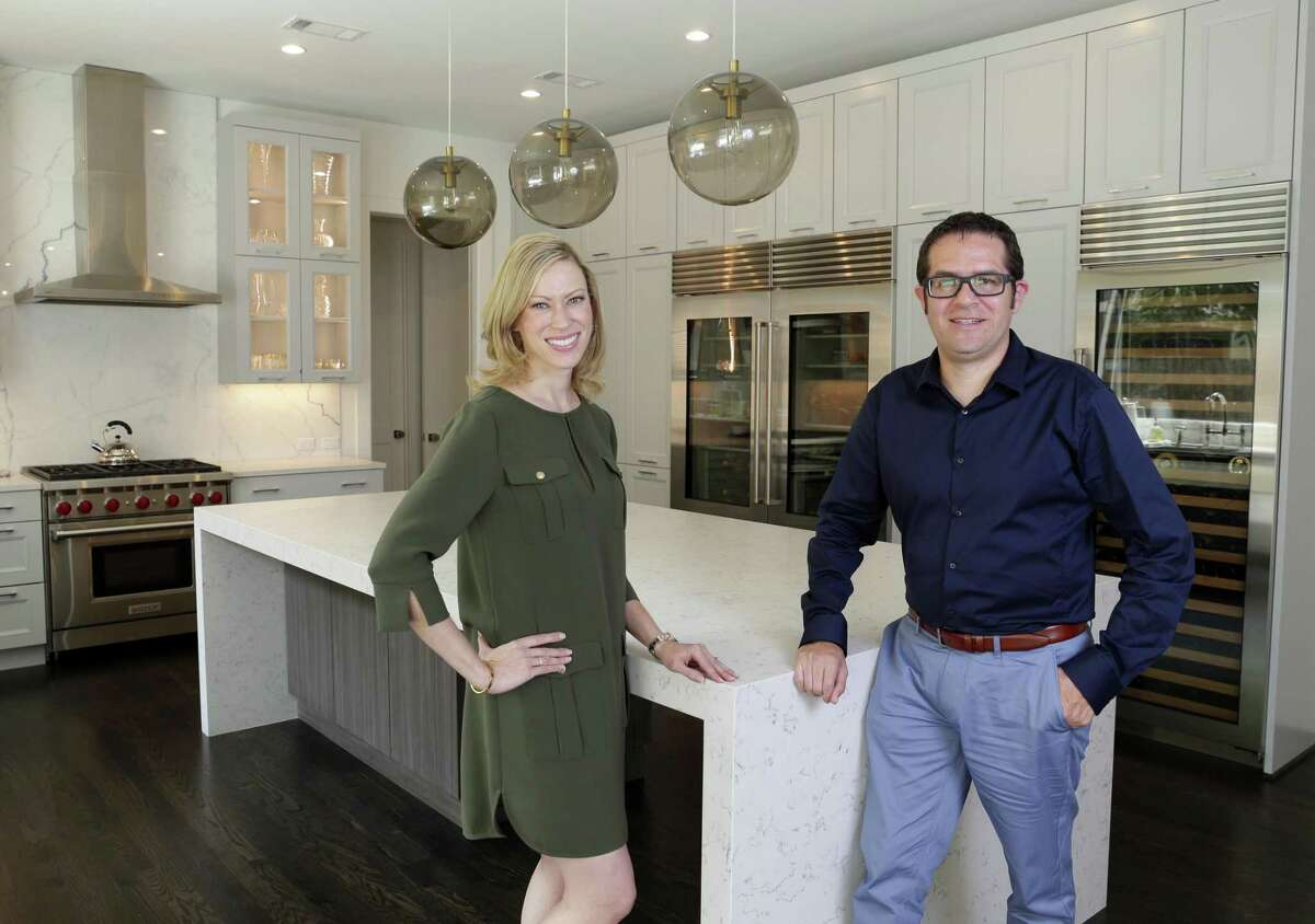 Home owner Jennifer Askari and architect Javier Medina in the kitchen of the Askari home, part of the modern changes to the traditional home in the Tanglewood district Friday, Sept. 7, 2018 in Houston, TX.