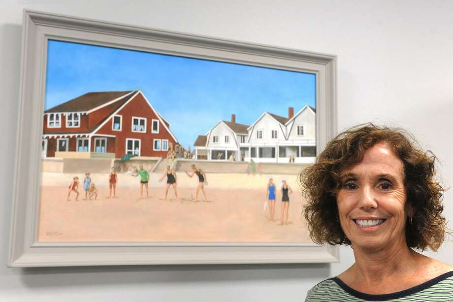 Staff Attorney Kate Maxham stands next to a painting by artist and historian Bill Lee that hangs in the Fairfield Probate Court office, in Fairfield, Conn. Sept. 6, 2018. Lee's painting depicts his childhood memories of time he spent on the beach in Fairfield in the 1920's. Photo: Ned Gerard / Hearst Connecticut Media / Connecticut Post