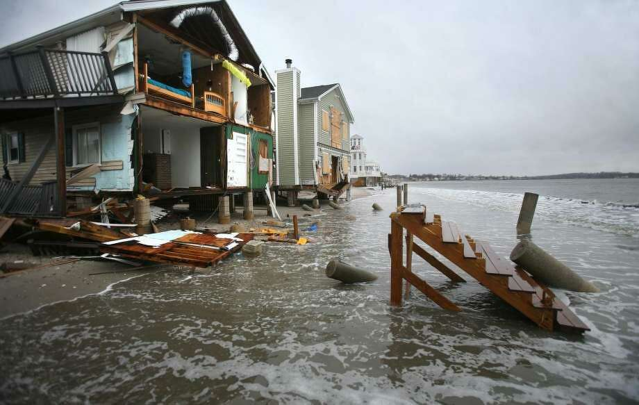 Storm tides reach waterfront homes devastated by Superstorm Sandy on East Broadway in Milford on Thursday, December 27, 2012. Photo: / File Photo