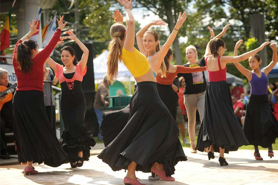 Marina Freudzon and Patricia Rodriguez Faraone, both of New Haven, at center, dance the flamenco with students from the Melinda Marquez Flamenco Dance Center of New Haven at the annual Stratford Hispanic Heritage Month Celebration on Paradise Green in Stratford, Conn. on Sunday, September 10, 2017. Photo: Brian A. Pounds / Hearst Connecticut Media / Connecticut Post