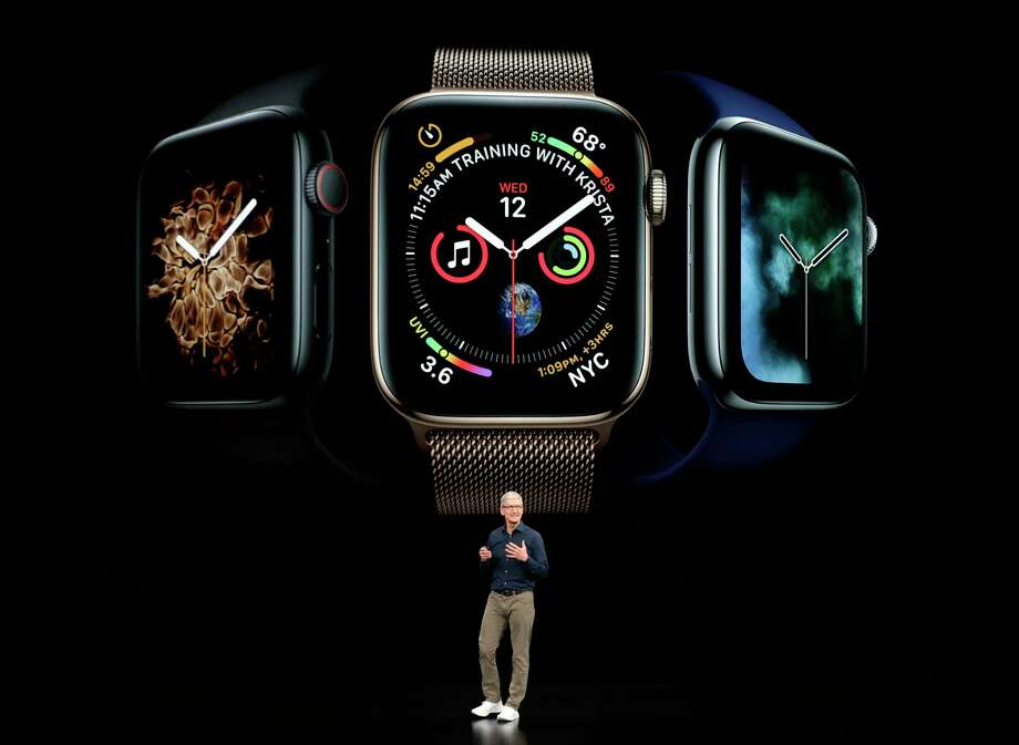 Apple CEO Tim Cook discusses the new Apple Watch 4 at the Steve Jobs Theater during an event to announce new products Wednesday, Sept. 12, 2018, in Cupertino, Calif. (AP Photo/Marcio Jose Sanchez) Photo: Marcio Jose Sanchez / Copyright 2018 The Associated Press. All rights reserved