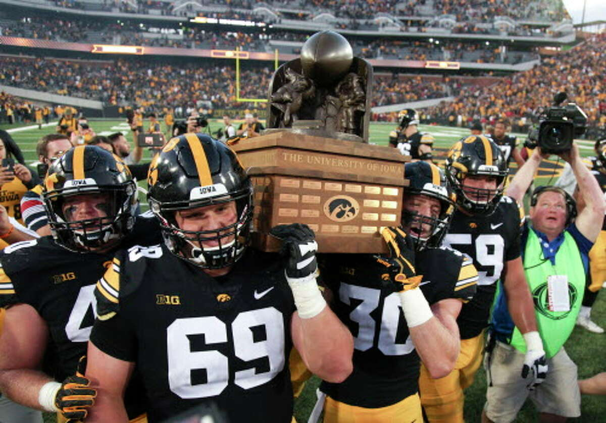 No. 23: Iowa Conference:Big Ten Revenue:$79 million Profit:$38 million Pictured:Hawkeyes players carry the Cy-Hawk trophy after the match-up against the Iowa State Cyclones on September 8, 2018 at Kinnick Stadium, in Iowa City, Iowa.