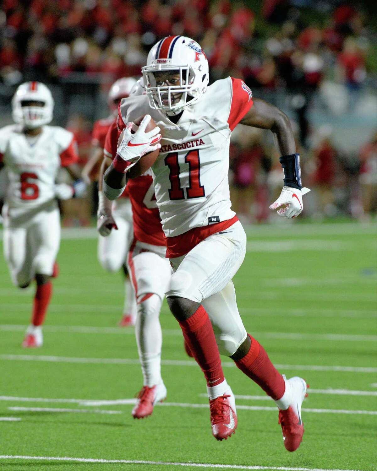 Dylan Robinson (11) of Atascocita rushes for a touchdown in the third quarter of a high school football game between the Katy Tigers and the Atascocita Eagles on Saturday, September 8, 2018 at Legacy Stadium, Katy, TX.