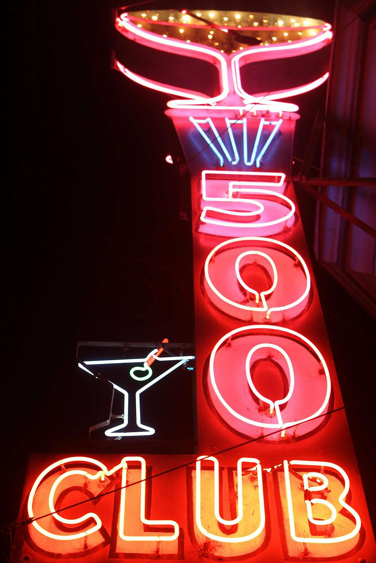 The big martini glass and the tall 500 Club sign attracts people passing by in the mission in San Francisco, Calif., on Thursday December 4, 2014.