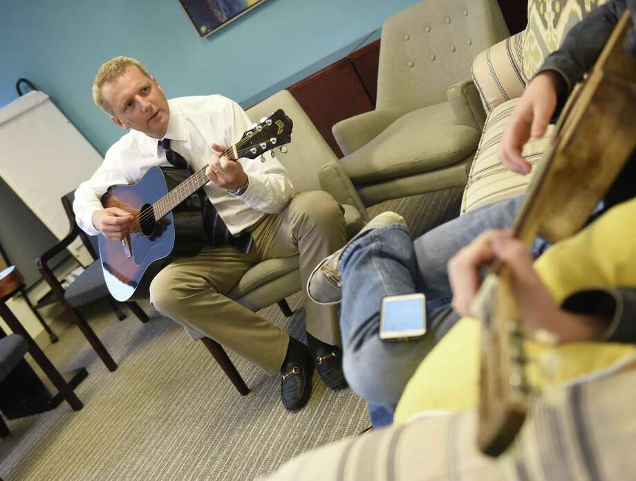 Anxiety Institute Founder and Director of Admissions and Outreach Daniel Villiers, Ph.D, plays guitar with a patient at the Anxiety Institute in Greenwich on Wednesday. Photo: Tyler Sizemore / Hearst Connecticut Media / Greenwich Time