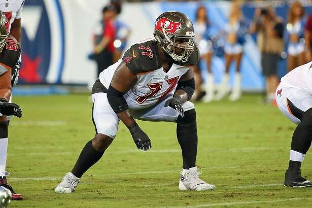 NASHVILLE, TN - AUGUST 18: Caleb Benenoch #77 of the Tampa Bay Buccaneers plays during a pre-season game against the Tennessee Titans at Nissan Stadium on August 18, 2018 in Nashville, Tennessee. (Photo by Frederick Breedon/Getty Images)