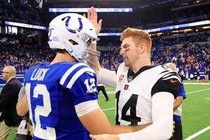 INDIANAPOLIS, IN - SEPTEMBER 09:  Andy Dalton #14 of the Cincinnati Bengals and Andrew Luck #12 of the Indianapolis Colts meet after the game at Lucas Oil Stadium on September 9, 2018 in Indianapolis, Indiana.  (Photo by Andy Lyons/Getty Images)