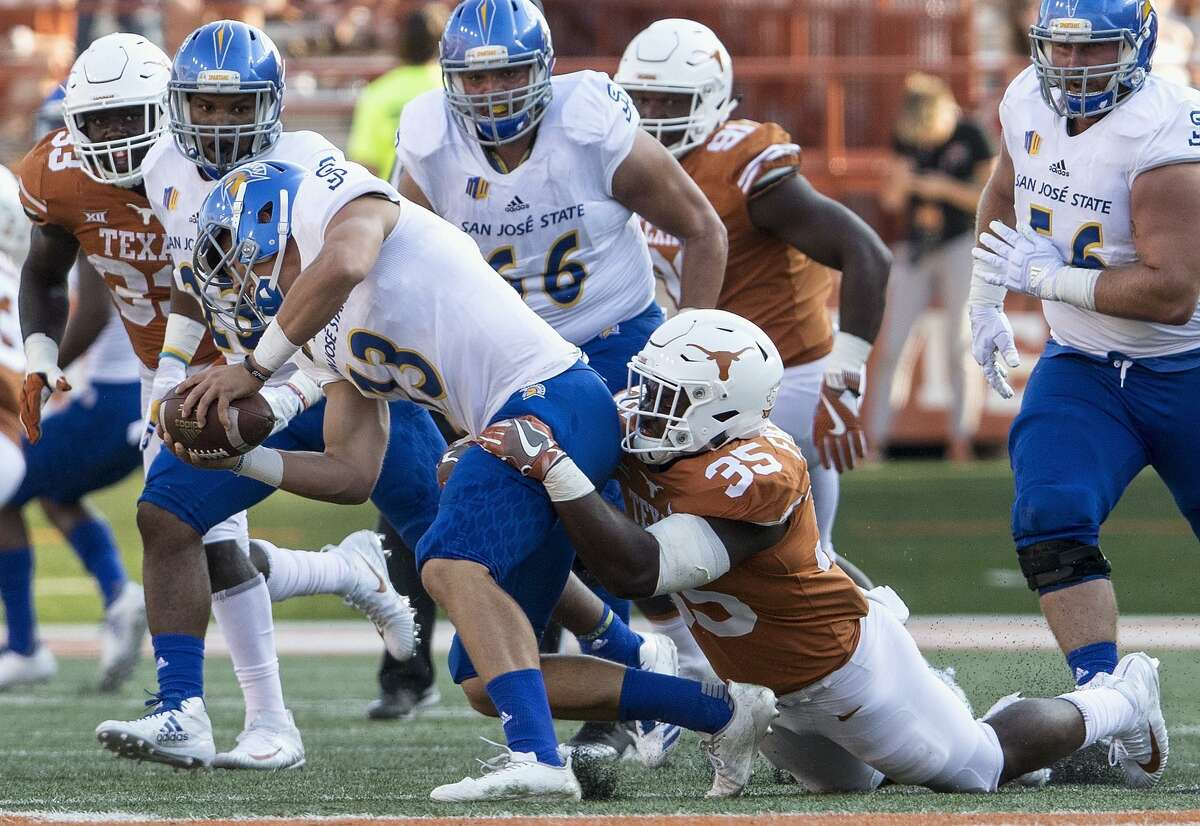 Sam Allen #13 of the San Jose State Spartans is sacked by Edwin Freeman #35 of the Texas Longhorns in the fourth quarter at Darrell K Royal-Texas Memorial Stadium on September 9, 2017 in Austin, Texas.