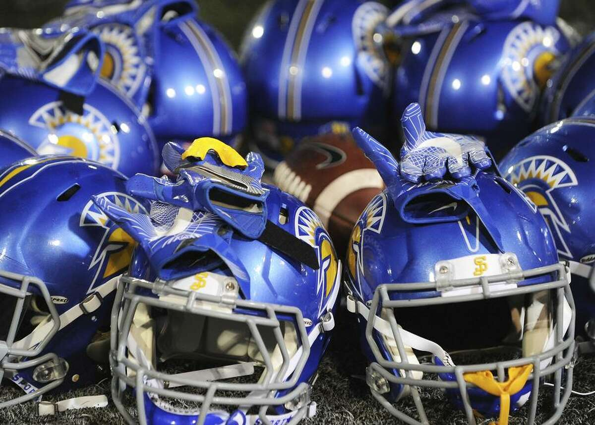 October 15, 2016: Helmets from San Jose State Spartans football players sit on the field during warm ups before the start of a NCAA football game between the University of Nevada Wolfpack and the San Jose State Spartans at CEFCU Stadium in San Jose, CA.