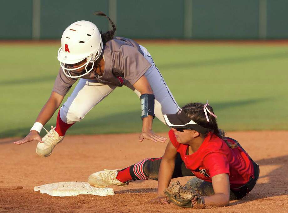 Bryanna Bell #2 of Atascocita flies over Comal Canyon shortstop Sydney Belvin (1) as she steals second base in the sixth inning of the Class 6A state championship game during the UIL State Softball Championships at Red & Charline McCombs Field on Saturday, June 2, 2018, in Austin. Photo: Jason Fochtman, Staff Photographer / Houston Chronicle / © 2018 Houston Chronicle