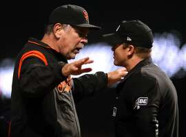 San Francisco Giants' manager Bruce Bochy is thrown out for arguing after Brandon Crawford was called out on strikes in 12th inning of 5-3 loss to Colorado Rockies during MLB game at AT&T Park in San Francisco, CA on Thursday, May 17, 2018.