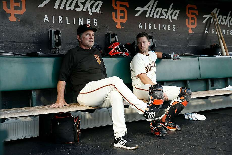 SAN FRANCISCO, CA - AUGUST 31: Manager Bruce Bochy #15 of the San Francisco Giants sits and chats with catcher Buster Posey #28 in the dugout before the game against the St Louis Cardinals at AT&T Park on August 31, 2017 in San Francisco, California. ~~ Photo: Lachlan Cunningham, Getty Images