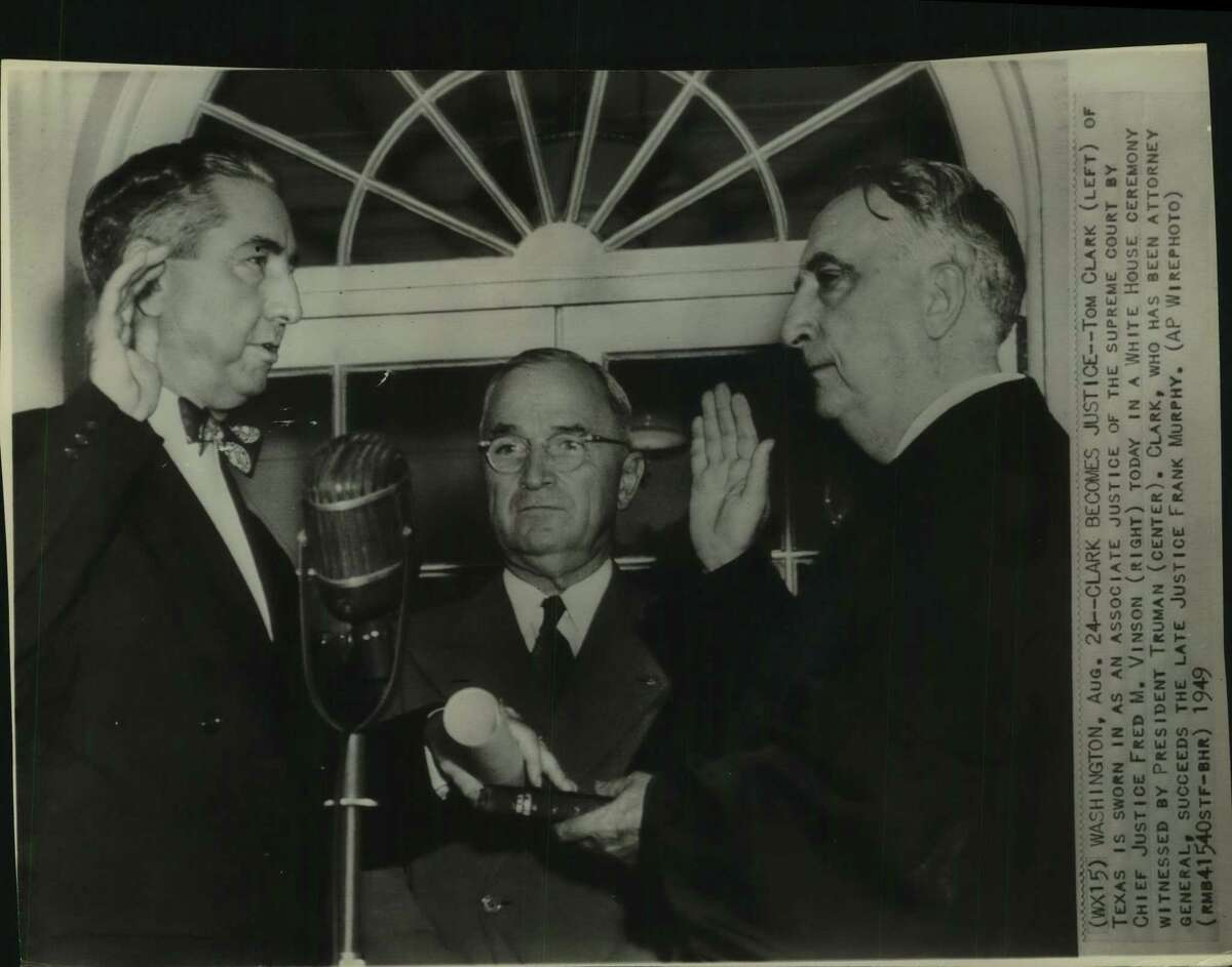 Tom Clark, left, of Texas is sworn in as an associate justice of the supreme court in 1949 by Chief Justice Fred M. Vinson, right, in a White House ceremony witnessed by President Truman. Clark had been Truman's attorney general and his nomination caused a stir.