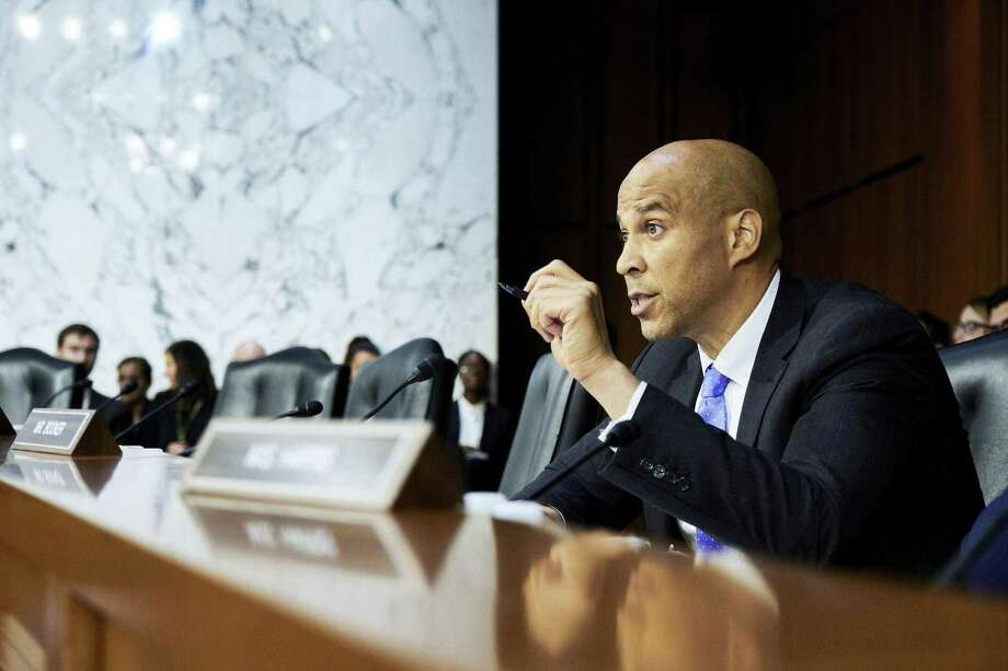 "Sen. Cory Booker questions Judge Brett Kavanaugh, President Donald Trumps nominee for the U.S. Supreme Court, during his confirmation hearing before the Senate Judiciary Committee on Sept. 5. Booker said his plan to divulge confidential documents may have been as close as possible to his own ""I am Spartacus"" moment. Photo: T.J. KIRKPATRICK /NYT / NYTNS"