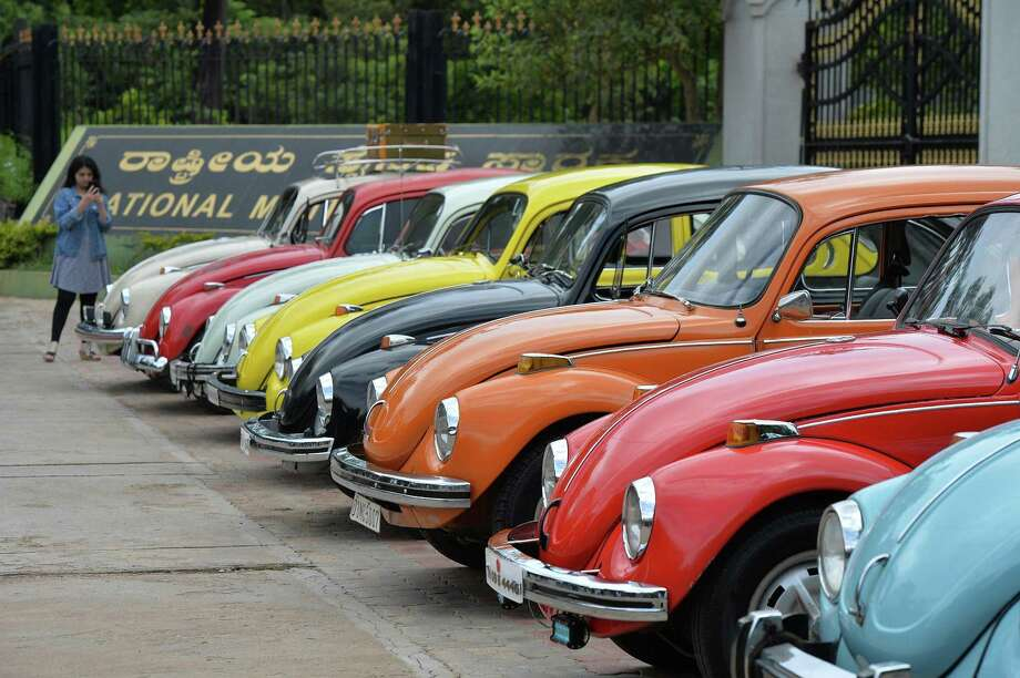 "In this file photo taken on June 24, 2018 vintage Volkswagen Beetle cars are parked in a row during a rally held as part of the 23rd anniversary of ""World Wide VW Beetle Day"", in Bangalore. - Volkswagen announced on September 13, 2018 that it would end production of its iconic ""Beetle"" cars in 2019 following a pair of final editions of the insect-inspired vehicles.The move comes as Volkswagen emphasizes electric autos and larger family-oriented vehicles, said Hinrich Woebcken, chief executive of Volkswagen Group of America. But Woebcken opened the door to reviving the model at some point, saying ""never say never."" Photo: MANJUNATH KIRAN /AFP /Getty Images / AFP or licensors"