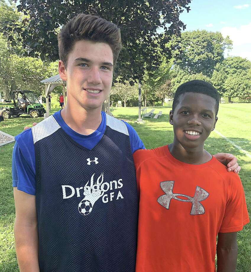 Greens Farms Academy's Aidan Murphy, a sophomore soccer player, stands with Republic of Malawi native Zobran Elias, an exchange student at Indian Mountain School in Lakeville, following a recent soccer practice in Westport. Murphy went to Malawi for a soccer journey and Elias will be living in Darien with the Murphy family during the upcoming school year. Photo: Contributed Photo / Greens Farms Academy