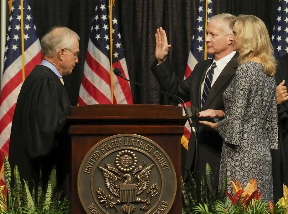 Judge David Counts, United States District Judge Western District of Texas, takes his oath of office from Judge Robert Junell 09/13/18 as his wife, Jill Counts, holds his Bible during his investiture ceremony at the Midland Horseshoe Tim Fischer/Reporter-Telegram Photo: Tim Fischer/Midland Reporter-Telegram