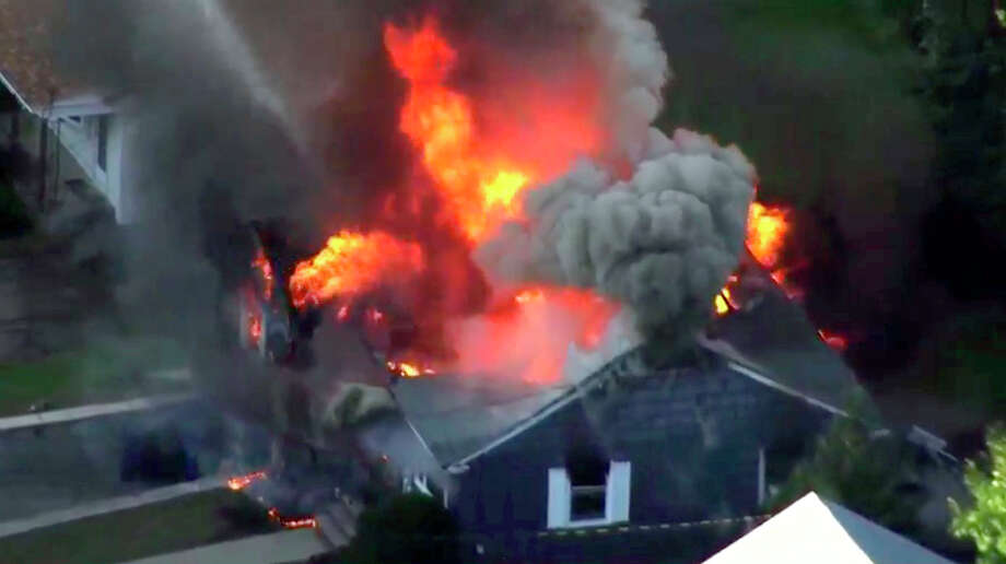 In this image take from video provided by WCVB in Boston, flames consume a home in Lawrence, Mass, a suburb of Boston, Thursday, Sept. 13, 2018. Emergency crews are responding to what they believe is a series of gas explosions that have damaged homes across three communities north of Boston. (WCVB via AP) Photo: Associated Press