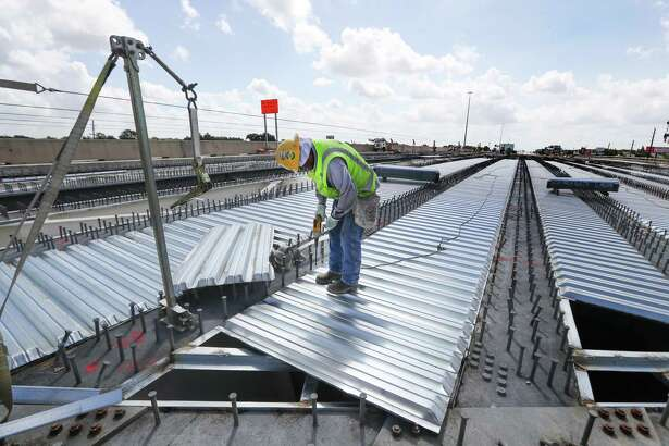 A worker lays steel for a bridge along the U.S. 290 project near Fairbanks North Houston Road on June 28, 2018, in Houston.