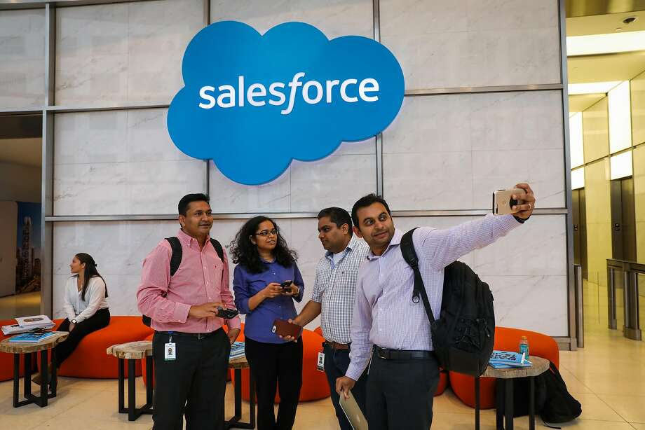 Monish Venu takes a selfie with friends Pragnesh Desai (left), Pavani Mangipudi and Neeraj Vishnuvardhan in the lobby of Salesforce Tower in San Francisco. As Salesforce grows, its chief wonders whether San Francisco has enough space for its employees. Photo: Gabrielle Lurie / The Chronicle