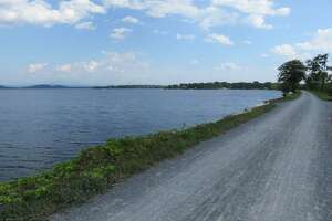 The Colchester Causeway, part of Vermont's Island Line Trail, runs out into Lake Champlain. (Herb Terns / Times Union)