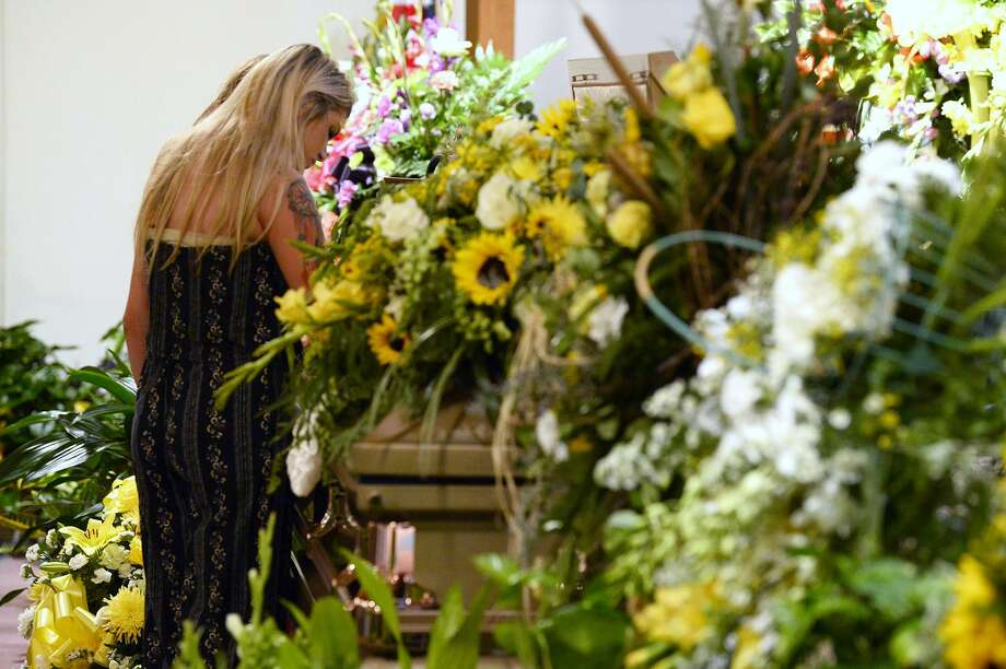 Family members say goodbye during the funeral for Caringtin Mosley at First Baptist Church of Batson on Thursday. Mosley, 18, was killed along with two of her friends in a car wreck on Sunday. 
