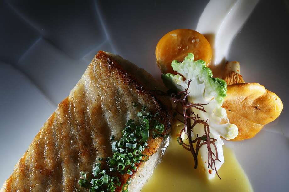 European turbot - cauliflower, husk cherry, chanterelle, preserved lemon- from course four of Michael Mina's 6 course menu is seen on Friday, September 7,  2018 in San Francisco, Calif. Photo: Lea Suzuki, The Chronicle