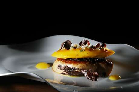 Glazed egyptian mango - foie gras, candied ginger, MINA spice- from course two of Michael Mina's 6 course menu is seen on Friday, September 7,  2018 in San Francisco, Calif.
