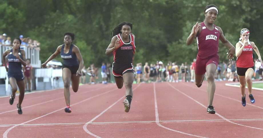 Terry Miller of Bulkeley-Hartford wins the girls 100-meter dash at the CIAC Class M Outdoor Track and Field Championships in May, ahead of Andraya Yearwood of Cromwell (third from left). Photo: Peter Hvizdak / Hearst Connecticut Media / New Haven Register