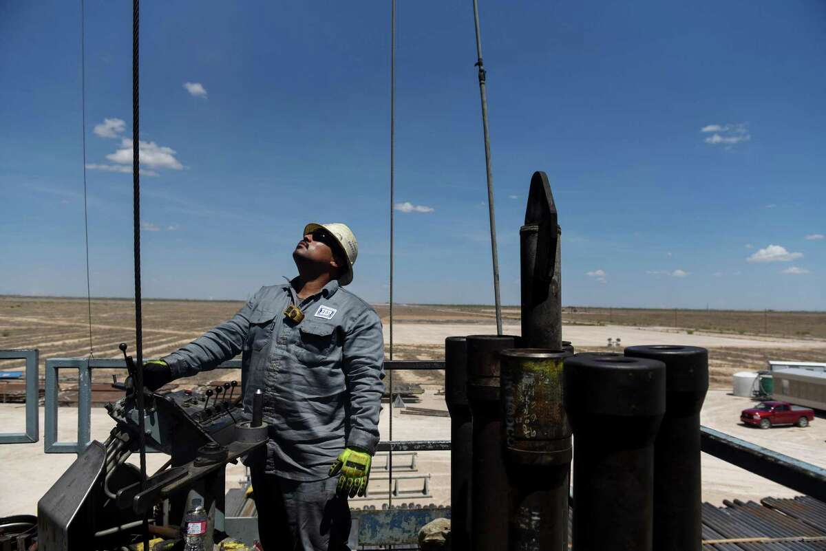 A contractor maneuvers drilling pipe at a Colgate Energy LLC oil rig in Reeves County. After the oil bust, oil and gas companies cut the costs of prodcution, but analysts wonder if those savings have topped out. Spending on water management in the Permian Basin, for example, is likely to nearly double to more than $22 billion in just five years, according to industry consultant IHS Markit.