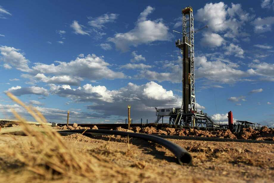 A Colgate Energy LLC oil drilling rig stands in Reeves County .After the oil bust, oil and gas companies cut the costs of prodcution, but analysts wonder if those savings have topped out. Spending on water management in the Permian Basin, for example, is likely to nearly double to more than $22 billion in just five years, according to industry consultant IHS Markit. Photo: Callaghan O'Hare / Bloomberg / © 2018 Bloomberg Finance LP