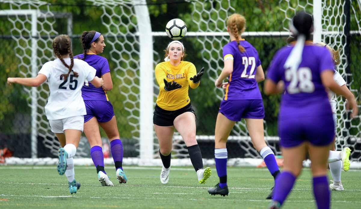 Westhill goalie Niamh Keogh (1) grabs the ball in front of the goal in a FCIAC girls soccer game against Wilton at Westhill High School on Thursday, Sept. 13, 2018 in Stamford, Connecticut. The Vikings of Westhill and the Warriors of Wilton played to a 0-0 tie.