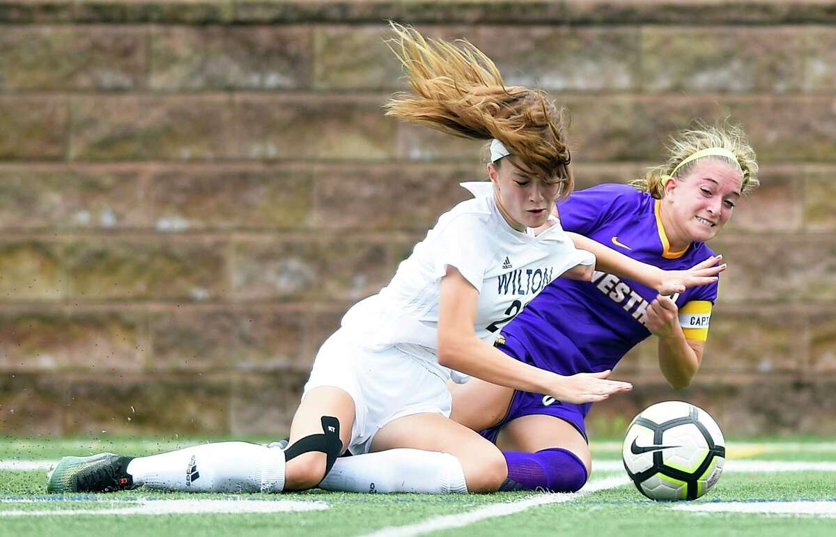Wilton's Shelby Dejana (21) and Westhill Claudia Benz (6) battle for the ball in a FCIAC girls soccer game at Westhill High School on Thursday, Sept. 13, 2018 in Stamford, Connecticut. The Vikings of Westhill and the Warriors of Wilton played to a 0-0 tie.