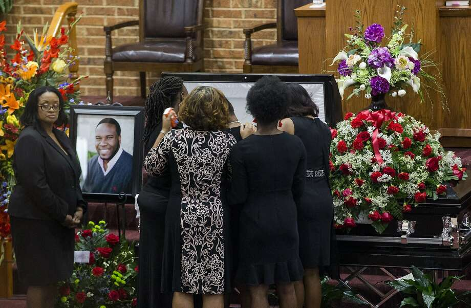 Mourners comfort Allison Jean, Botham Jean's mother, during the public viewing before the funeral of Botham Shem Jean at the Greenville Avenue Church of Christ on Thursday, Sept. 13, 2018, in Richardson, Texas. He was shot and killed by a police officer in his Dallas apartment. Photo: Shaban Athuman, TNS
