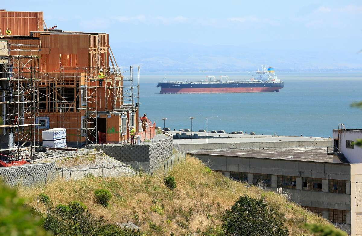 New construction on Parcel A (l to r) is seen next to structures at Hunter's Point Shipyard on Thursday, May 17, 2018 in San Francisco, Calif.