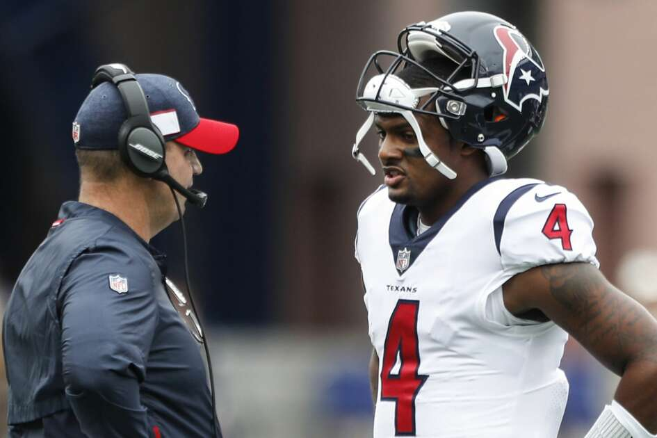 Houston Texans head coach Bill O'Brien talks to quarterback Deshaun Watson (4) during a time out in the first quarter of an NFL football game against the New England Patriots at Gillette Stadium on Sunday, Sept. 9, 2018, in Foxborough, Mass.